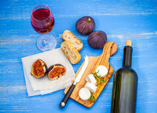 Goat cheese with ripe figs and wine royalty free stock photography