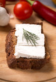 Goat cheese rye bread Stock Photography