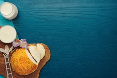 Goat cheese with saffron, bread and milk on turquoise background. View from above royalty free stock photography