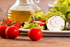 Goat cheese with salad and cherry tomatoes. Royalty Free Stock Photography