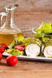 Goat cheese with salad and cherry tomatoes. Stock Photography