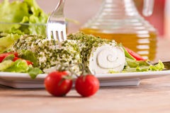 Goat cheese with salad and cherry tomatoes. Royalty Free Stock Photo