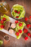 Goat cheese with salad and cherry tomatoes. Royalty Free Stock Image
