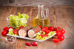 Goat cheese with salad and cherry tomatoes. Stock Photos