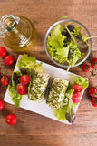 Goat cheese with salad and cherry tomatoes. Stock Image