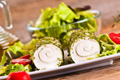 Goat cheese with salad and cherry tomatoes. Stock Photo