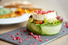 Goat cheese salad with vegetables at restaurant Royalty Free Stock Photos