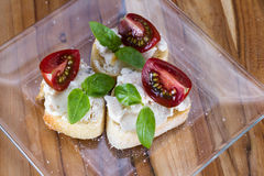 Goat cheese and tomato appetizer Royalty Free Stock Photo