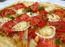 Goat cheese and tomato tart Royalty Free Stock Photography
