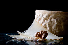 Goat cheese and walnut. On black background stock photography