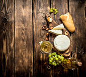 Goat cheese with white wine and nuts. On a wooden table stock photo