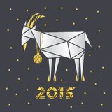 Goat Christmas paper on a dark gray background with the ball Royalty Free Stock Photo