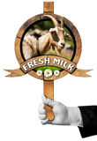 Goat Fresh Milk -  Sign with Hand of Chef Royalty Free Stock Photography