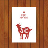 Goat greeting card. Symbol of the 2015 year, greeting card with. Goat. Vector watercolor background. Greeting card 2015. Happy New Year 2015. Wood texture Royalty Free Stock Images
