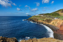 Goat island and lighthouse in Terceira, wide angle stock image