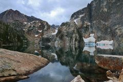 Goat Lake with lichen covered boulders in the foreground. Stock Photos