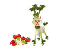Goat made of fennel standing with vegetables Stock Image