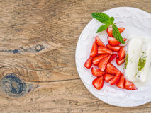 Goat milk ice-cream with pistachio and strawberry Royalty Free Stock Image
