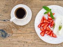 Goat milk ice-cream with pistachio and strawberry Royalty Free Stock Photos