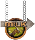 Goat Milk - Wooden Sign with Arrow and Chain Stock Image
