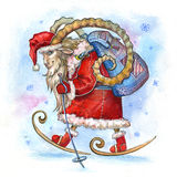 Goat Santa. Old goat dressed as Santa. With the bag, skiing Royalty Free Stock Photos