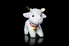 Goat or sheep the symbol 2015 year. White goat or sheep toy the chinese symbol of 2015 year on black background with reflection stock photos