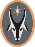 Goat and star. Stylized goat's head and star in oval in grey, white, black, orange colors as a symbol of upcoming fortune in New Year Stock Photos