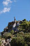 Goat on top of mountian, Refugio de Juanar, Spain. Goat statue on top of a mountain, Refugio de Juanar, Near Marbella, Costa del Sol, Malaga Province, Andalusia Royalty Free Stock Image