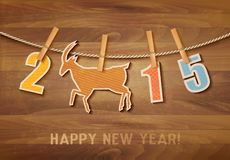 2015 with a goat on wooden background. Vector Vector Illustration