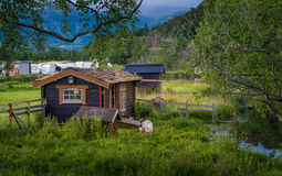 Goat and wooden cabin Stock Images