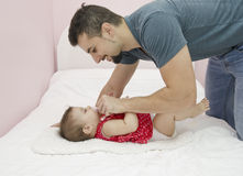 Goatee daddy. Young dad and baby portrait in home bedroom Stock Photography