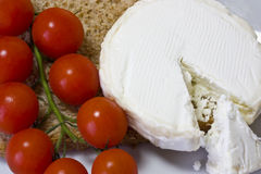 Goats cheese and tomatoes  Stock Photography