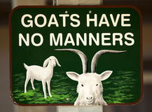 Goats Have No Manners. Funny sign royalty free stock images