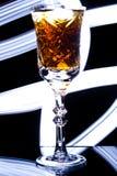 Gobelet avec de l'alcool Photographie stock