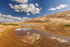 Gobi Desert after rain. Reflection of clouds in pools Royalty Free Stock Photography