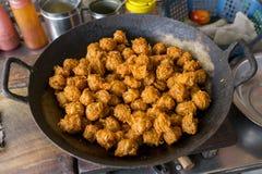 Gobi Manchurian. Dry - Popular street food of India made of cauliflower florets, selective focus Royalty Free Stock Photography