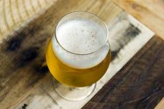 Goblet of beer against wood background Stock Image