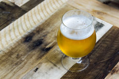 Goblet of beer against wood background Stock Photo
