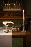 Holy Communion. Goblet, candle, and other items on a small altar in a church Royalty Free Stock Photography