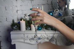 Goblet of champagne in womans hands Royalty Free Stock Images