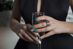 Goblet of champagne in womans hands Stock Photography