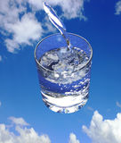 Goblet filled with clean drinking water, heavenly background Stock Photos