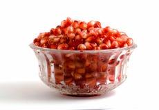 Goblet full of pomegranate arils. Isolated on white background stock photo
