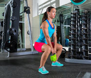 Goblet kettlebell squat woman workout at gym. Goblet kettlebell squat woman workout exercise at gym royalty free stock photos