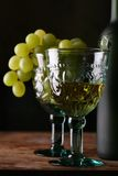 Goblet with new wines. Goblet in medieval style with new wines, still-life with grape Royalty Free Stock Photos