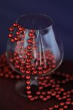 A goblet with red beads Stock Photos
