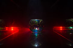 Goblet with smoke on black red background with reflections. Long shutter Royalty Free Stock Photo