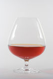 Goblet of spirit. Transparent goblet with a strong drink. Concept of holiday, romance or luxury Stock Image