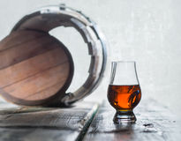 Goblet of whiskey and old barrel Royalty Free Stock Photography