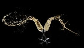 Goblets with champagne wine splashing out stock image